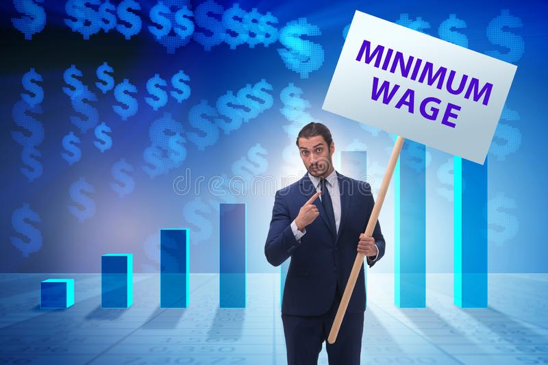 Concept of minimum wage with businessman. The concept of minimum wage with businessman royalty free stock photography