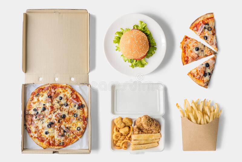 Concept of mock up burger, fried chicken, pizza and french fries on white background. Copy space for text and logo. Set fast food. Concept of mock up burger stock image