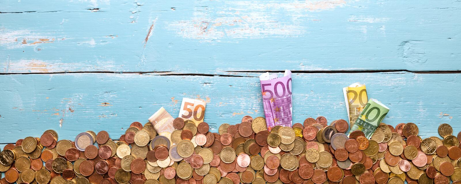 Concept Money, investment and save up, growing and plant euro co. Ins and banknotes on blue background royalty free stock photos