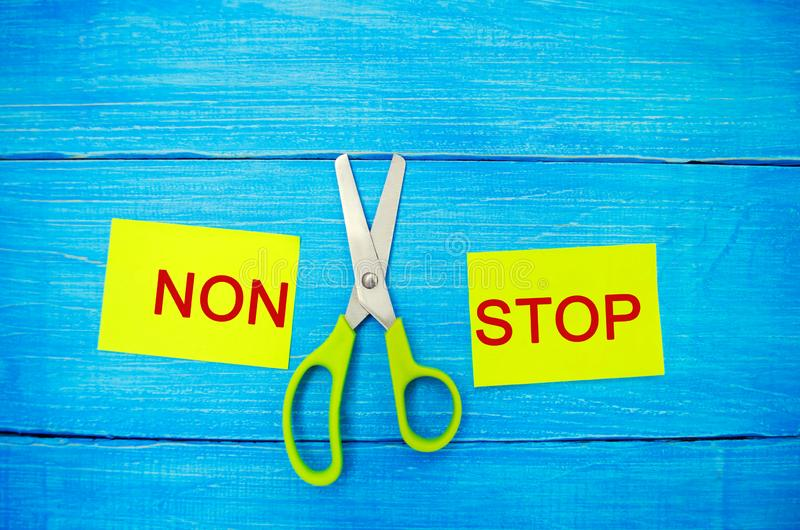 Concept of motivation. the inscription `non stop` and scissors between them. goal achievement, potential overcoming. stock photos