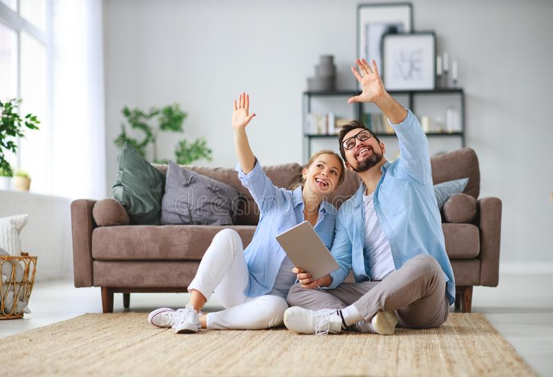 Concept of moving, buying home. married couple plans to repair and project apartment. Concept of moving, buying home. young married couple plans to repair and a royalty free stock photography