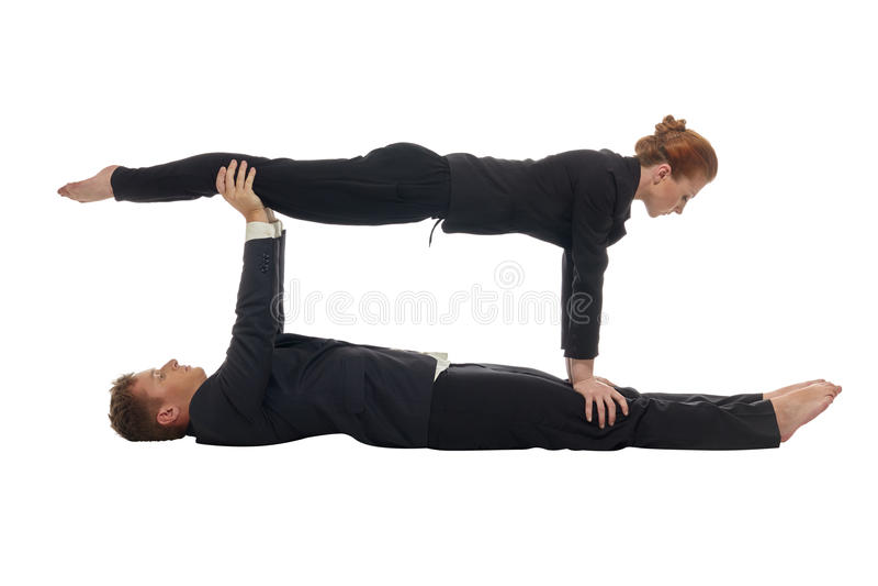 Concept of multitasking. Acrobats keep balance royalty free stock photography