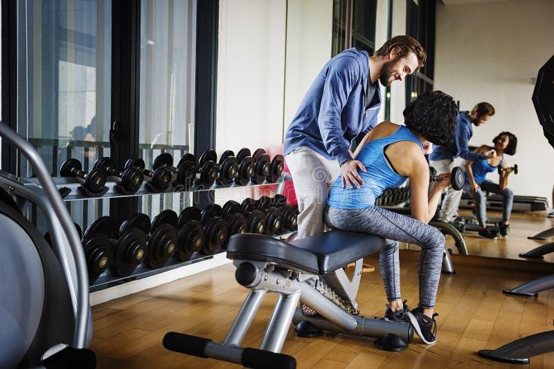 Concept musculaire de passe-temps de Sport-usage de couples de séance d'entraînement images libres de droits