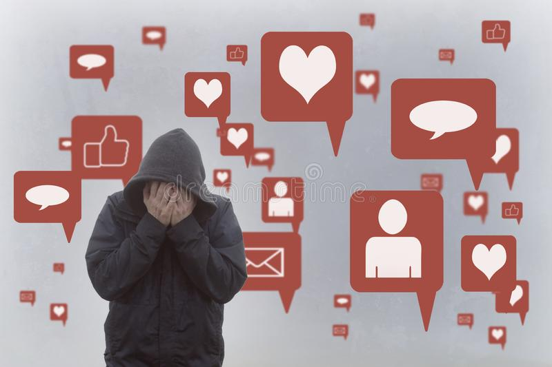 A concept of the negative effects of social media. A hooded man holding his head in his hands. With social media icons surrounding vector illustration