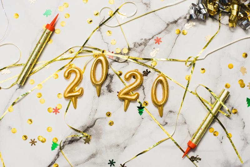 The concept of the new 2020 and Christmas. Candles in the shape of numbers 2020 as a symbol of the new year next to christmas. Shaped sparkler candles fountain royalty free stock image