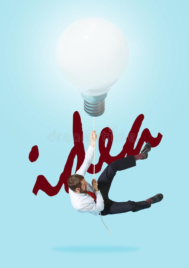 Concept of a new idea. A man going with a lamp stock illustration
