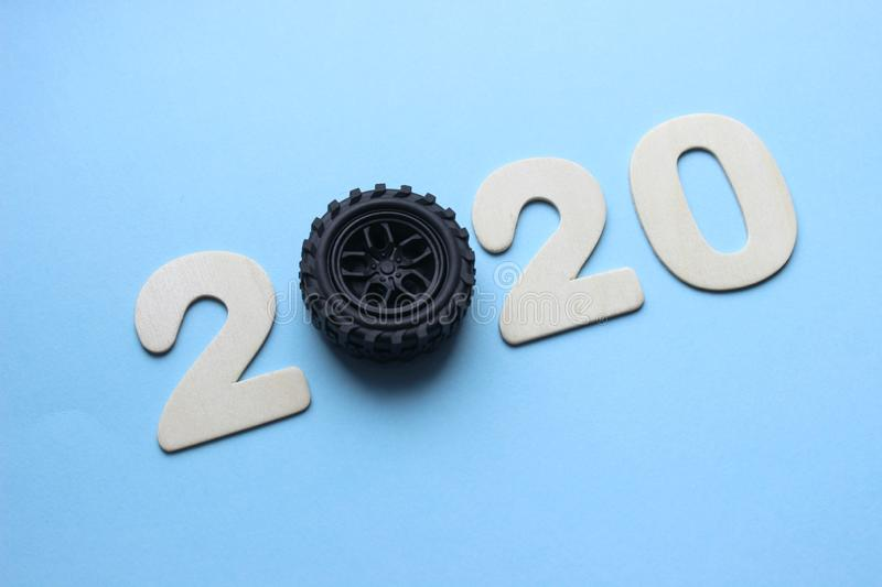 2020. The concept of the new year. The figures 2020 are isolated on a blue background, instead of the number 0 car wheel. royalty free stock photo