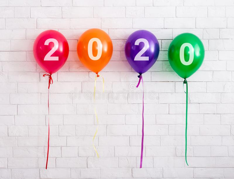2020 concept new year party balloons with white text stock image
