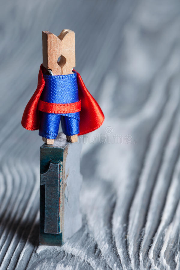 Concept number one. Clothespin superhero man on the top. stock images