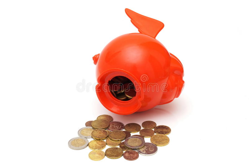 Concept od spending savings with coins and piggy. A concept od spending savings with coins and piggy stock photos