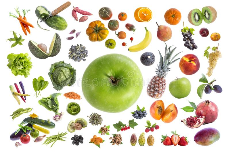 Concept of healthy food, Various Fruits and vegetables to eat five a day on withte background with a green apple in the royalty free stock photo