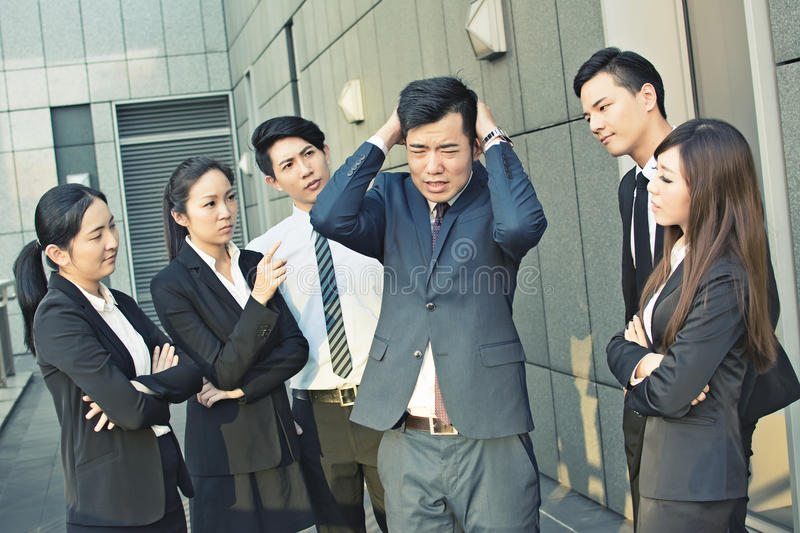 Concept of office bully. Or fight with men and women in the city stock photo