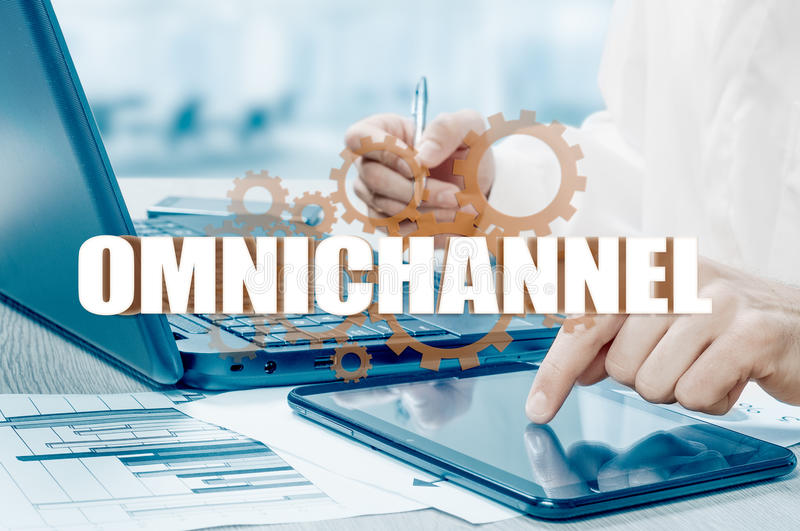 The concept of Omnichannel between devices to improve the performance of the company. Innovative solutions in business.  royalty free stock images