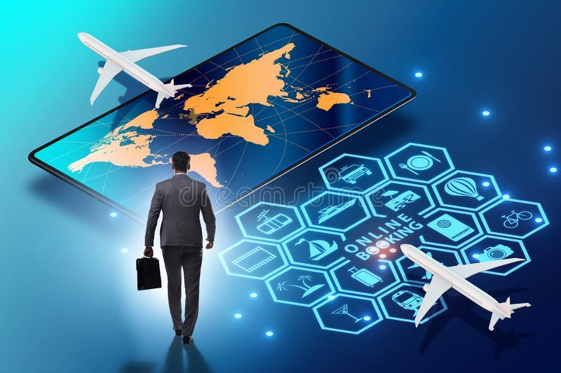 Concept of online airtravel booking with businessman stock images
