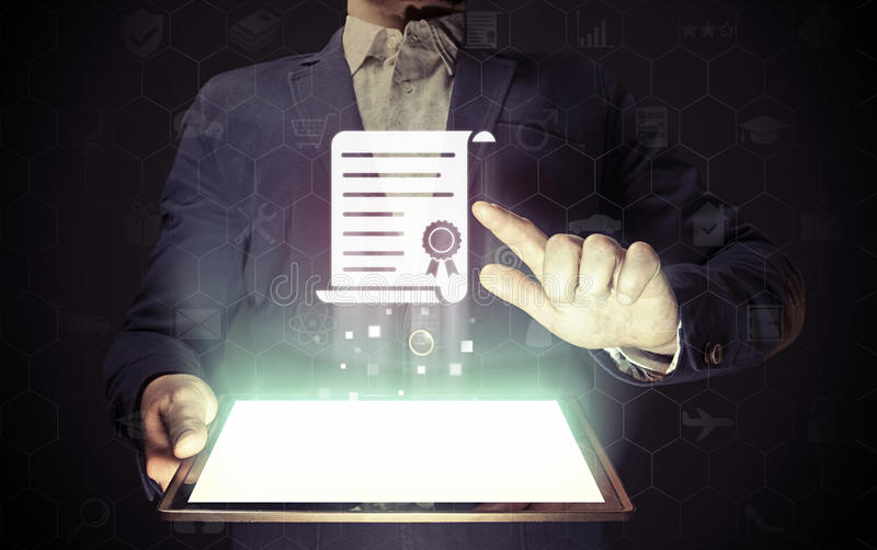 Concept of online learning. Man touches to certificate icon diploma. He holds tablet pc, that contains a many different online services royalty free stock image