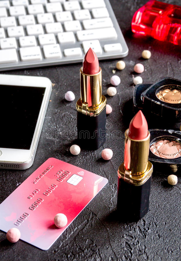 Concept online shopping cosmetics on dark background with keyboard.  stock photos