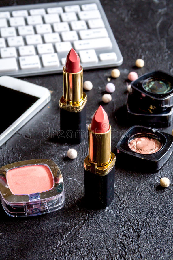 Concept online shopping cosmetics on dark background with keyboard.  royalty free stock image