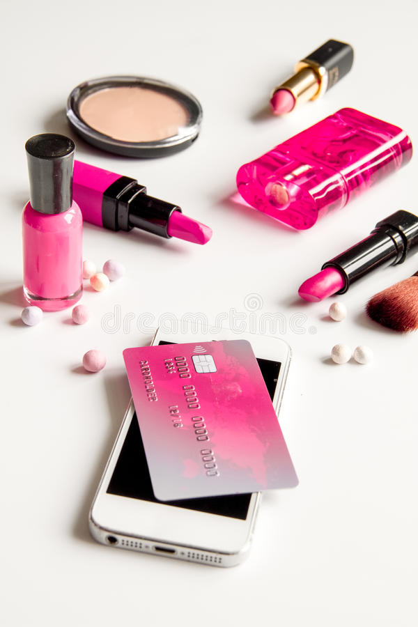 Concept online shopping cosmetics on white background. Close up stock images