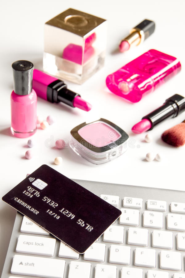 Concept online shopping cosmetics on white background. Close up royalty free stock photography