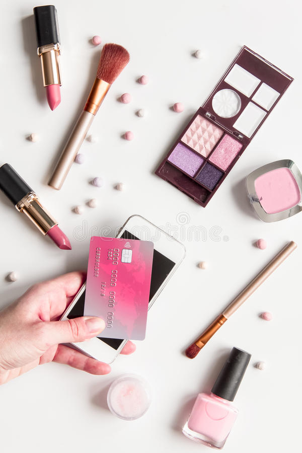 Concept online shopping cosmetics on white background top view.  stock image
