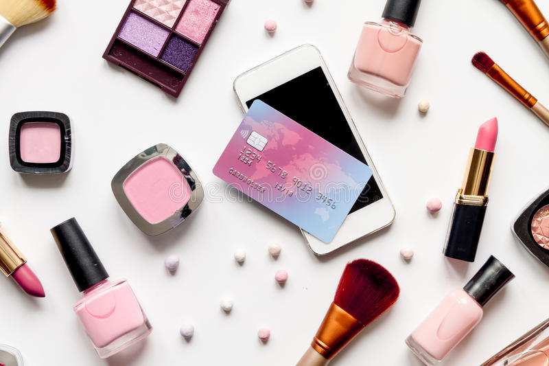 Concept online shopping cosmetics on white background top view.  royalty free stock photos