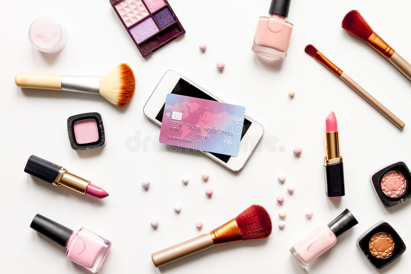 Concept online shopping cosmetics on white background top view.  stock photo