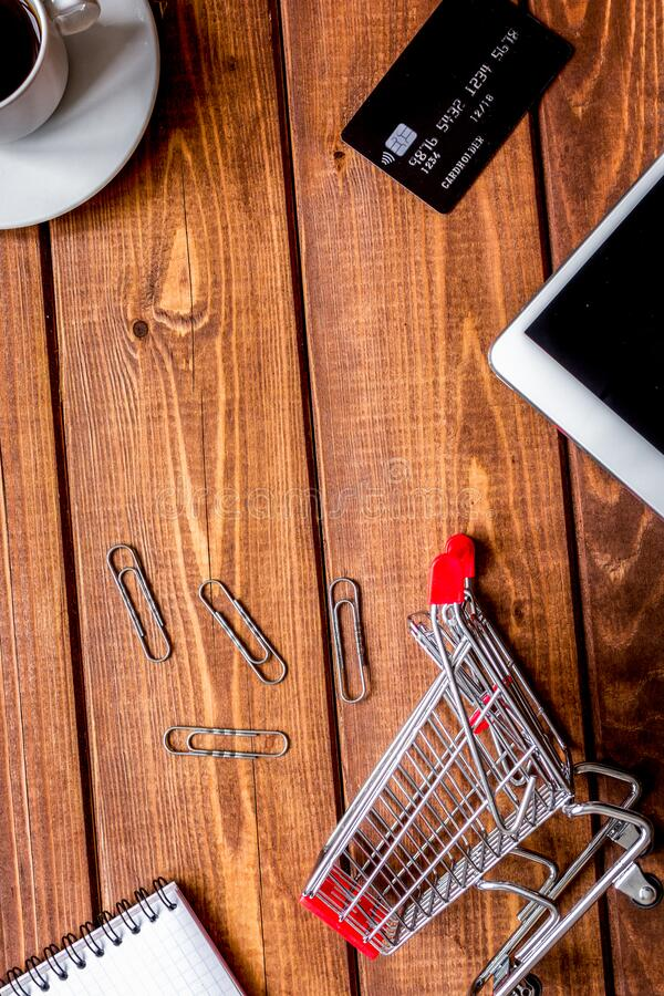 Concept online shopping with smartphone on wooden background mock up royalty free stock photos