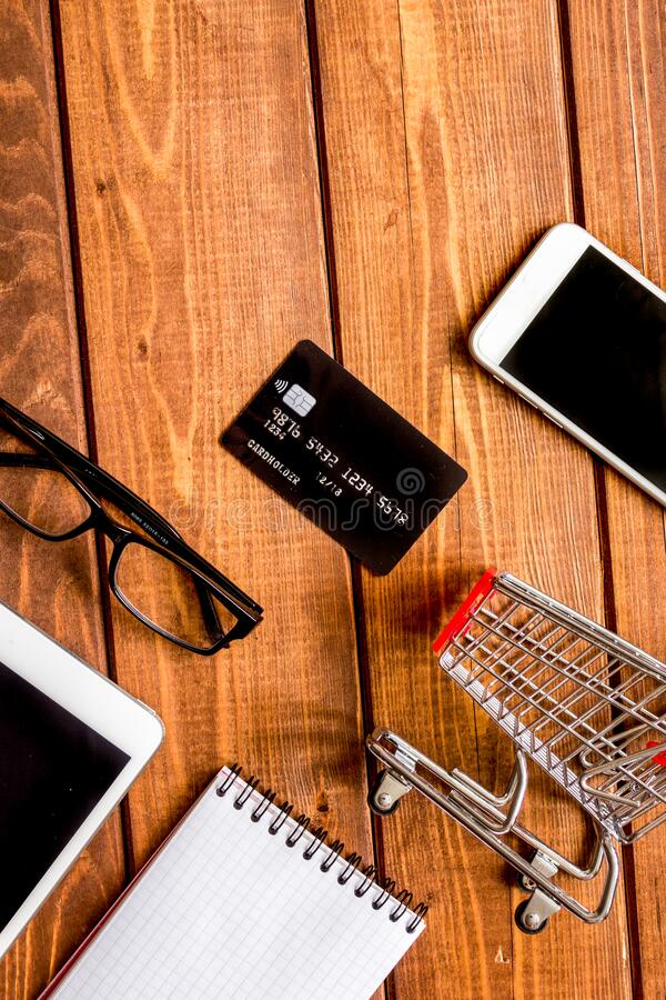 Concept online shopping with smartphone on wooden background mock up stock image