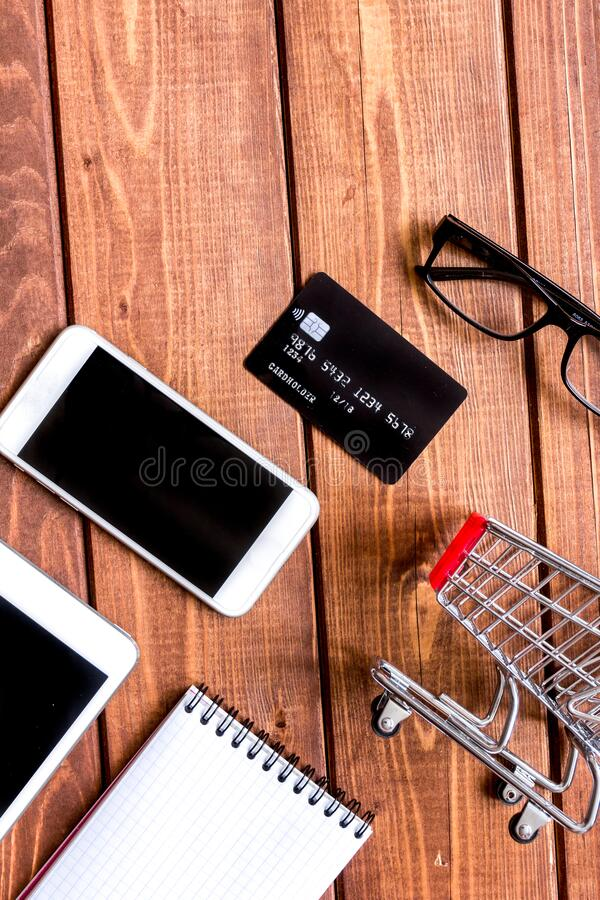 Concept online shopping with smartphone on wooden background mock up stock photo