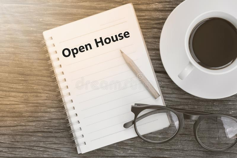 Concept Open House message on notebook with glasses, pencil and royalty free stock photography