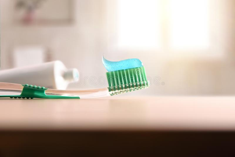 Concept oral hygiene with toothbrush on wood table in bathroom. Horizontal composition. Front view royalty free stock image