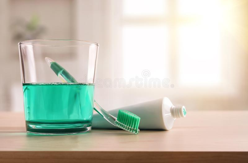 Concept oral hygiene on wood table in bathroom at home. With window in the background. Horizontal composition. Front view stock photos