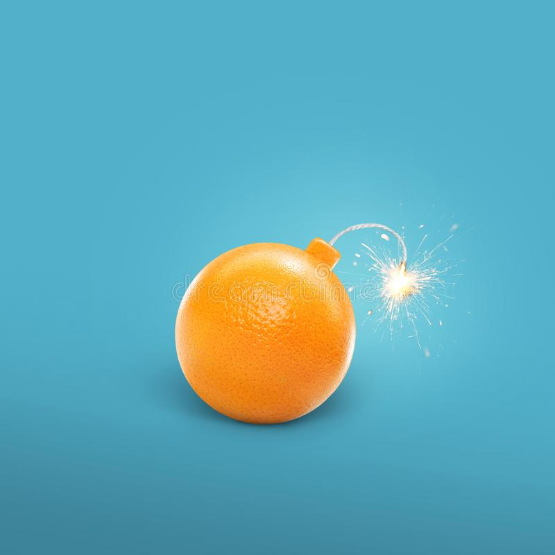 Concept of an orange bomb. Creative bomb with sparks. royalty free stock images