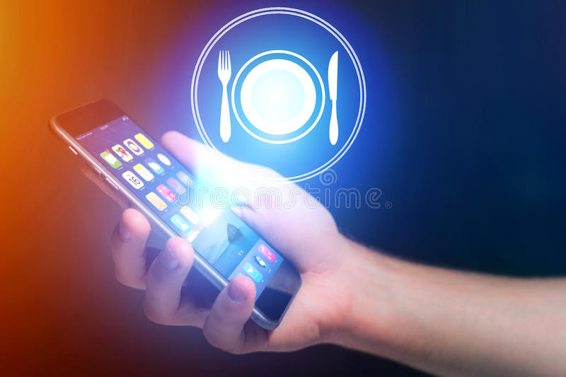 Concept of ordering online food with internet application - tech. Concept view of ordering online food with internet application - technology concept royalty free stock photos