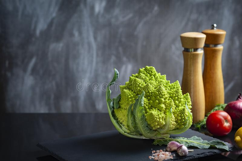 Concept of organic food with fresh vegetables: Romanesco broccoli, ripe tomatoes, red onion. stock images