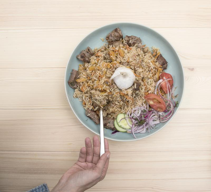 National Uzbek pilaf with meat royalty free stock images