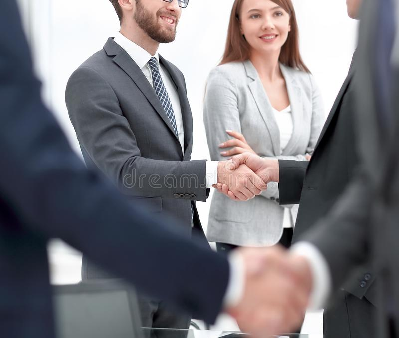 Concept of partnership.business handshake at officce stock photography