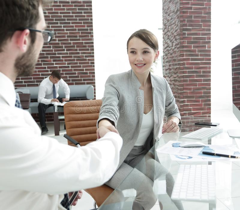 Business woman shaking hands with his business partner. Concept of partnership.business women shaking hands with his business partner royalty free stock image