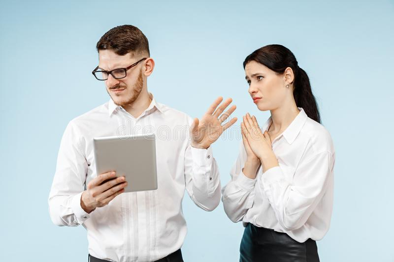 Concept of partnership in business. Young emotional man and woman standing at studio royalty free stock photo
