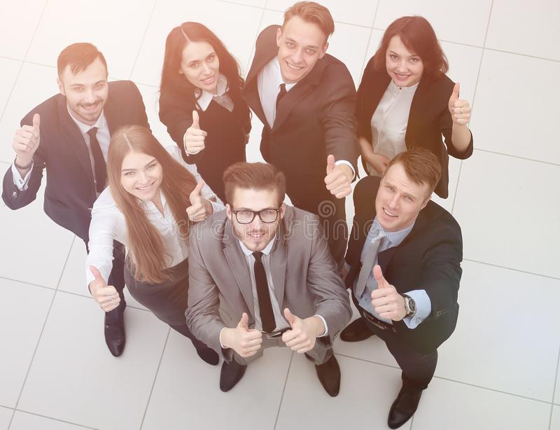 Group of successful employees showing thumbs up stock photography