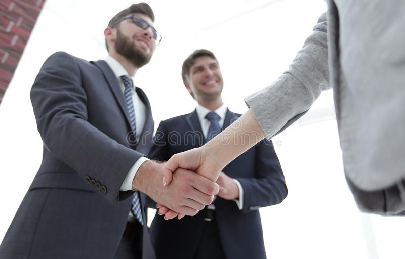 Close-up of business people shaking hands royalty free stock image