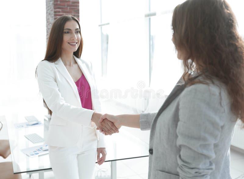 Welcome handshake women business partners stock photography