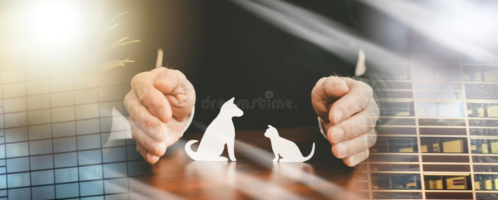 Concept of pet insurance; multiple exposure. Insurer protecting pets with his hands; multiple exposure royalty free stock photo