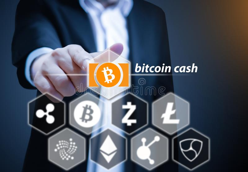 Concept photo of Business man points his finger at Bitcoin Cash icon. Cryptocurrency royalty free stock image