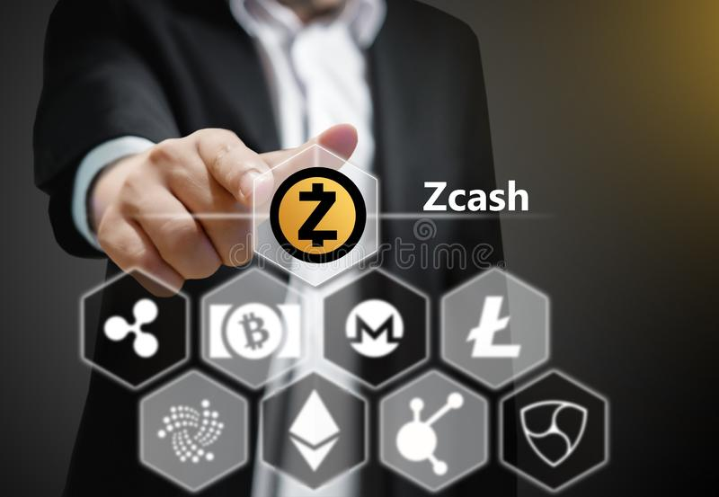 Concept photo of Business man points his finger at Zcash icon. Cryptocurrency royalty free stock photography