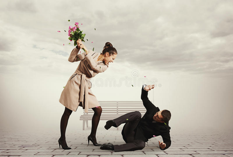 Concept photo of quarrel. Between young men and beautiful woman royalty free stock photos