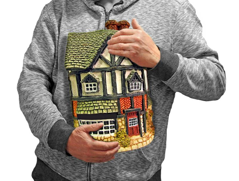 Mortgage home possession security landlord property. Concept photo of someone holding a house depicting home selling moving or possession landlord property etc stock image