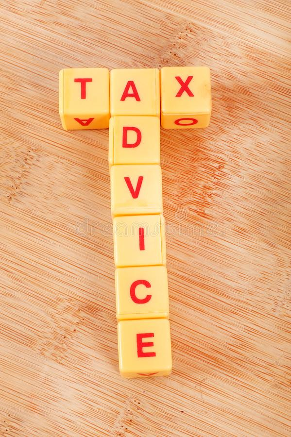Tax advice. Concept pic of tax advice on wooden background stock photography