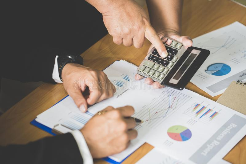 Concept picture for stock market, office, tax,and project. Two businessman investment consultant analyzing company financial stock photo