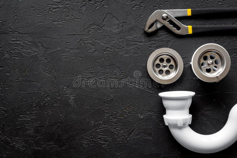 Concept plumbing work top view on dark background royalty free stock photos